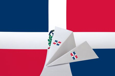 Dominican Republic flag depicted on paper origami airplane. Oriental handmade arts concept Stock Photo