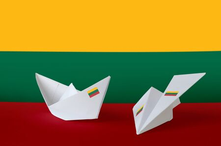 Lithuania flag depicted on paper origami airplane and boat. Oriental handmade arts concept