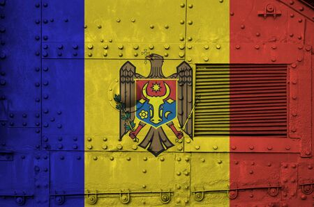 Moldova flag depicted on side part of military armored tank close up. Army forces conceptual background Stock Photo