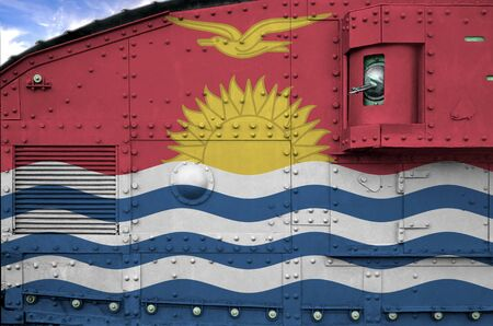 Kiribati flag depicted on side part of military armored tank close up. Army forces conceptual background