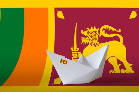 Sri Lanka flag depicted on paper origami ship closeup. Oriental handmade arts concept