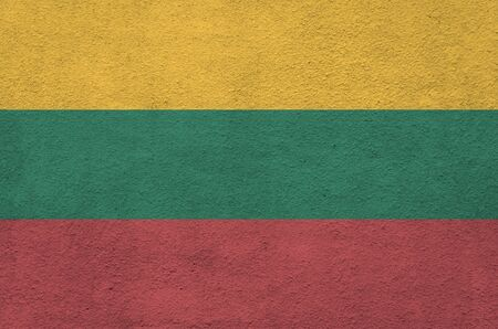 Lithuania flag depicted in bright paint colors on old relief plastering wall close up. Textured banner on rough background Reklamní fotografie
