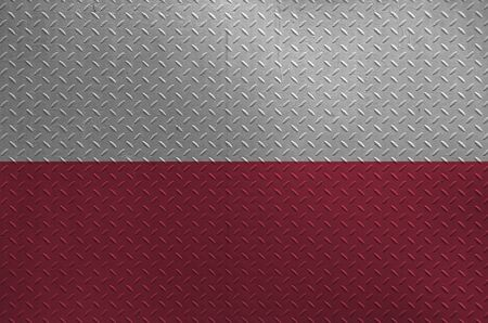 Poland flag depicted in paint colors on old brushed metal plate or wall close up. Textured banner on rough background