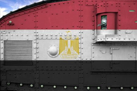 Egypt flag depicted on side part of military armored tank close up. Army forces conceptual background