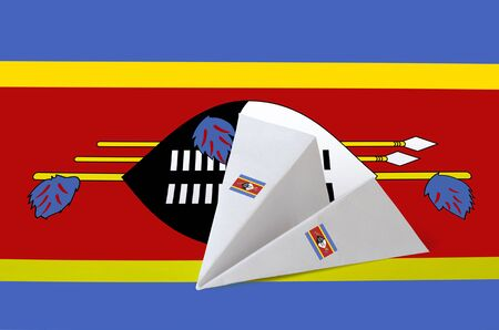 Swaziland flag depicted on paper origami airplane. Oriental handmade arts concept