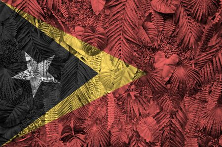 Timor Leste flag depicted on many leafs of monstera palm trees. Trendy fashionable background