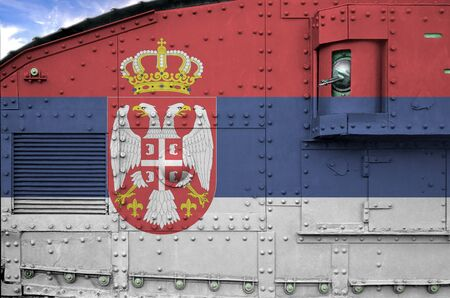 Serbia flag depicted on side part of military armored tank close up. Army forces conceptual background