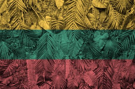 Lithuania flag depicted on many leafs of monstera palm trees. Trendy fashionable background