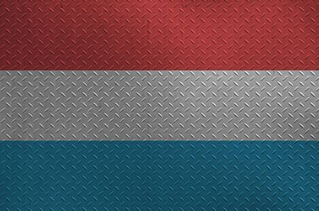 Luxembourg flag depicted in paint colors on old brushed metal plate or wall close up. Textured banner on rough background