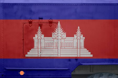 Cambodia flag depicted on side part of military armored truck close up. Army forces vehicle conceptual background Reklamní fotografie