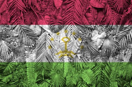 Tajikistan flag depicted on many leafs of monstera palm trees. Trendy fashionable background