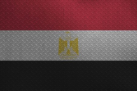 Egypt flag depicted in paint colors on old brushed metal plate or wall close up. Textured banner on rough background