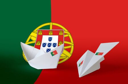 Portugal flag depicted on paper origami airplane and boat. Oriental handmade arts concept Stock fotó