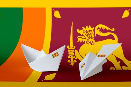 Sri Lanka flag depicted on paper origami airplane and boat. Oriental handmade arts concept