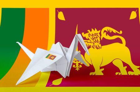 Sri Lanka flag depicted on paper origami crane wing. Oriental handmade arts concept Zdjęcie Seryjne