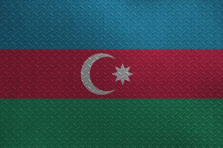 Azerbaijan flag depicted in paint colors on old brushed metal plate or wall close up. Textured banner on rough background Stockfoto