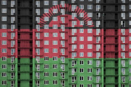 Malawi flag depicted in paint colors on multi-storey residental building under construction. Textured banner on big brick wall background Zdjęcie Seryjne - 135389652