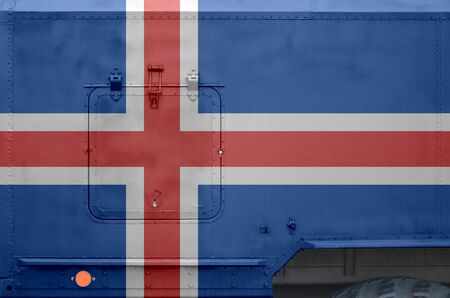 Iceland flag depicted on side part of military armored truck close up. Army forces vehicle conceptual background Banco de Imagens