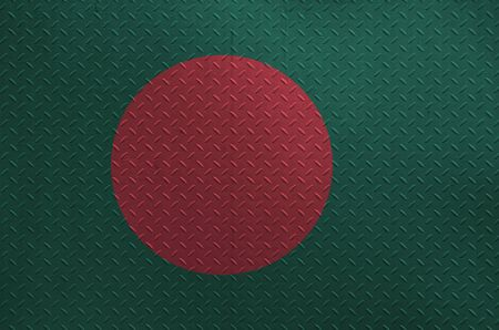 Bangladesh flag depicted in paint colors on old brushed metal plate or wall close up. Textured banner on rough background