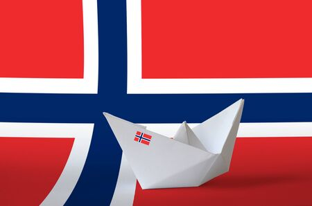 Norway flag depicted on paper origami ship closeup. Oriental handmade arts concept