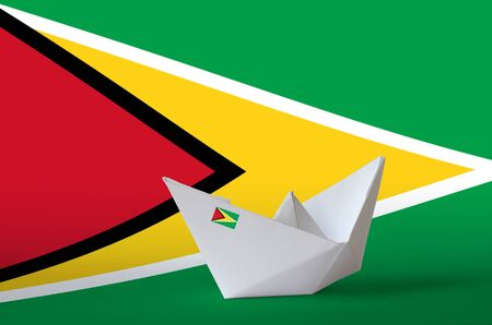 Guyana flag depicted on paper origami ship closeup. Oriental handmade arts concept