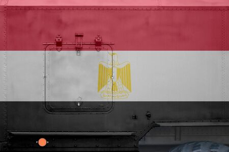 Egypt flag depicted on side part of military armored truck close up. Army forces vehicle conceptual background
