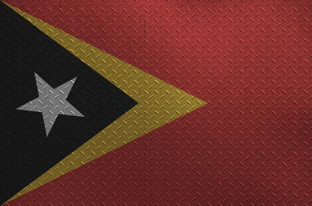 Timor Leste flag depicted in paint colors on old brushed metal plate or wall close up. Textured banner on rough background