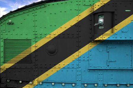 Tanzania flag depicted on side part of military armored tank close up. Army forces conceptual background Stock fotó