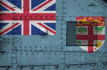 Fiji flag depicted on side part of military armored tank close up. Army forces conceptual background