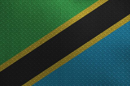 Tanzania flag depicted in paint colors on old brushed metal plate or wall close up. Textured banner on rough background