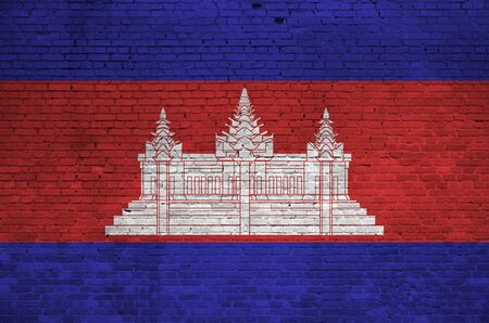 Cambodia flag depicted in paint colors on old brick wall close up. Textured banner on big brick wall masonry background
