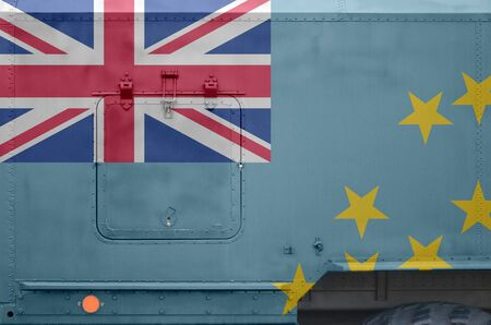 Tuvalu flag depicted on side part of military armored truck close up. Army forces vehicle conceptual background