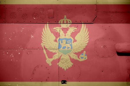 Montenegro flag depicted on side part of military armored helicopter close up. Army forces aircraft conceptual background