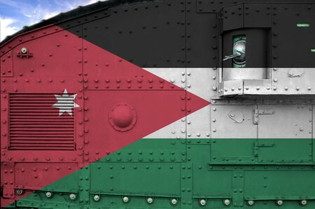 Jordan flag depicted on side part of military armored tank close up. Army forces conceptual background Фото со стока