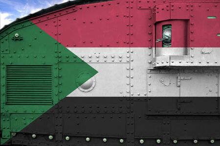 Sudan flag depicted on side part of military armored tank close up. Army forces conceptual background
