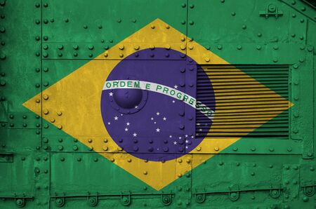 Brazil flag depicted on side part of military armored tank close up. Army forces conceptual background