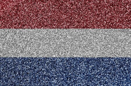 Netherlands flag depicted on many small shiny sequins. Colorful festival background for disco party