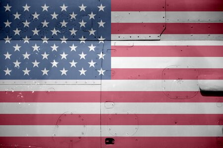 United States of America flag depicted on side part of military armored helicopter close up. Army forces aircraft conceptual background Фото со стока