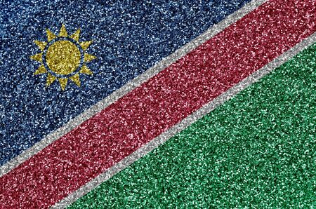 Namibia flag depicted on many small shiny sequins. Colorful festival background for disco party Фото со стока