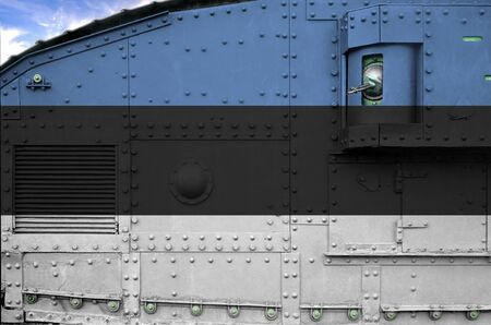 Estonia flag depicted on side part of military armored tank close up. Army forces conceptual background