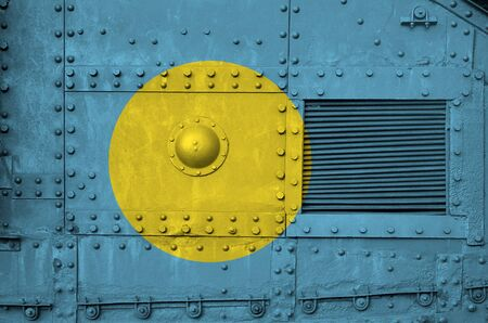 Palau flag depicted on side part of military armored tank close up. Army forces conceptual background