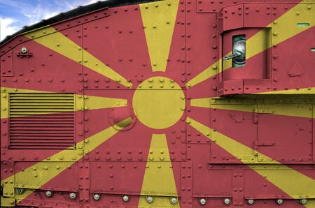 Macedonia flag depicted on side part of military armored tank close up. Army forces conceptual background