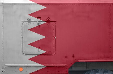 Bahrain flag depicted on side part of military armored truck close up. Army forces vehicle conceptual background Reklamní fotografie
