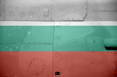 Bulgaria flag depicted on side part of military armored helicopter close up. Army forces aircraft conceptual background