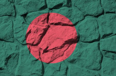 Bangladesh flag depicted in paint colors on old stone wall close up. Textured banner on rock wall background Stock fotó