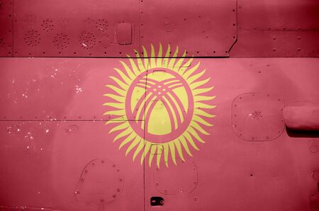 Kyrgyzstan flag depicted on side part of military armored helicopter close up. Army forces aircraft conceptual background