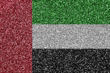 United Arab Emirates flag depicted on many small shiny sequins. Colorful festival background for disco party