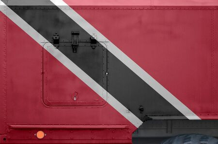 Trinidad and Tobago flag depicted on side part of military armored truck close up. Army forces vehicle conceptual background