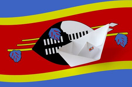Swaziland flag depicted on paper origami ship closeup. Oriental handmade arts concept