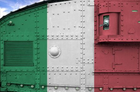 Italy flag depicted on side part of military armored tank close up. Army forces conceptual background Фото со стока